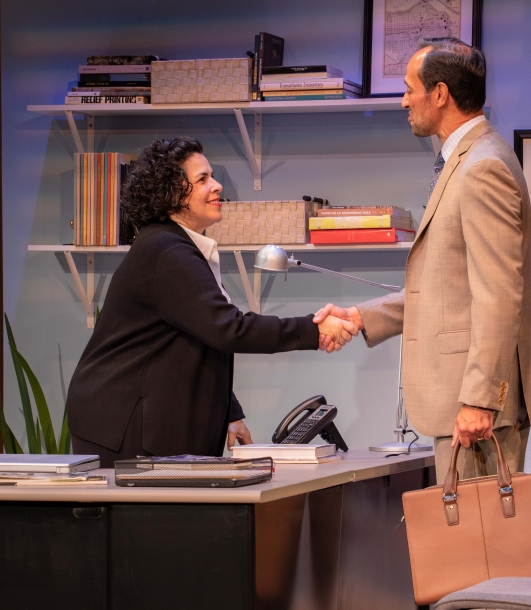 Carmen Pelaez (left) as Camila, greets art dealer Roman (Philip Hernandez) in FAKE, Miami New Drama's production of Pelaez's play. Photo by Stian Roenning.
